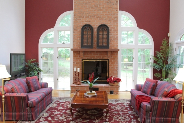 A deep, rich color takes center stage in this living room. COURTESY PHOTO