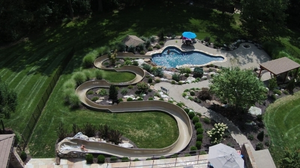 John Meredith's pool is complimented by a 210-foot custom, recycled waterslide designed by Jimmy James, owner of Fix My Slide. The company removes and refurbishes old commerical waterslides  ...