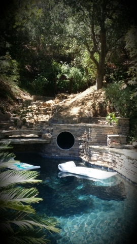 Some custom slides are built with more of a camoflauge feel and become a great entry to the pool without taking away from the oasis that already exists. COURTESY PHOTO