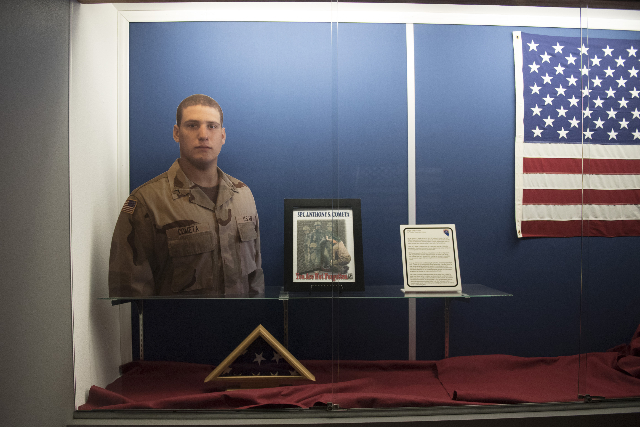 A display commemorating Army National Guard Spc. Anthony S. Cometa is shown at the Nevada Army National Guard Las Vegas Readiness Center/Anthony S. Cometa Complex in Las Vegas, Friday, July 17, 20 ...