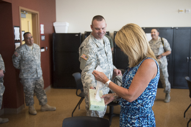 Nancy Cometa-Fontana, center, visits the building named for her late son at the Nevada Army National Guard Las Vegas Readiness Center/Anthony S. Cometa Complex in Las Vegas Friday, July 17, 2015.  ...