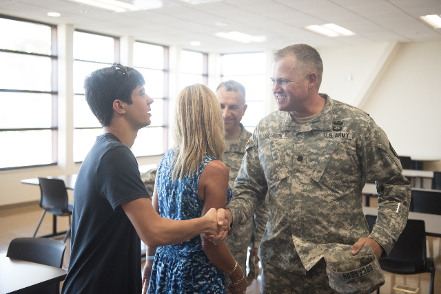 Matthew Fontana, 15, left, visits the building named for his late brother at the Nevada Army National Guard Las Vegas Readiness Center/Anthony S. Cometa Complex in Las Vegas Friday, July 17, 2015. ...