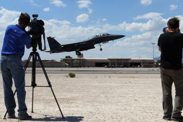 Photographers shoot a F-15E Strike Eagle from Mountain Home Air Force Base, Idaho, as it takes off during a Red Flag exercise at Nellis Air Force Base in Las Vegas Tuesday, July 21, 2015. (Erik Ve ...