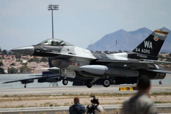 An F-16 Fighting Falcon from the 64th Aggressor Squadron at Nellis Air Force Base, takes off during a Red Flag exercise at Nellis Air Force Base in Las Vegas Tuesday, July 21, 2015. (Erik Verduzco ...