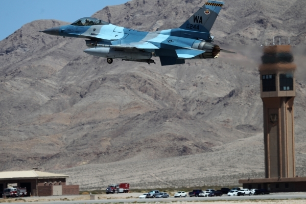 An F-16 Fighting Falcon from the 64th Aggressor Squadron at Nellis Air Force Base, heads off during a Red Flag exercise at Nellis Air Force Base in Las Vegas Tuesday, July 21, 2015. (Erik Verduzco ...
