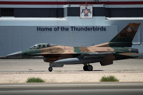 An F-16 Fighting Falcon from the 64th Aggressor Squadron at Nellis Air Force Base, gets ready to launch during a Red Flag exercise at Nellis Air Force Base in Las Vegas Tuesday, July 21, 2015. (Er ...