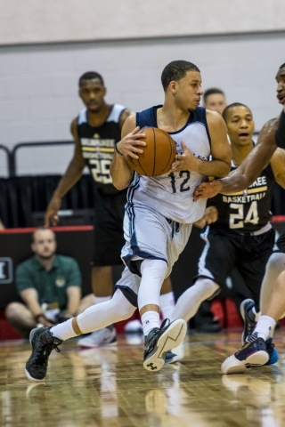 Seth Curry (12) of the New Orleans Pelicans looks to go on the outside of Jerome Randle (24) of the Milwaukee Bucks during an NBA Summer League game at Cox Pavilion in Las Vegas on Friday, July 10 ...