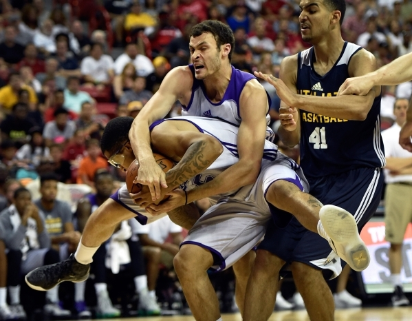 Los Angeles' Jabari Brown, left, grabs a rebound from his teammate Larry Nance Jr. and Utah's Trey Lyles (41) during an NBA Summer League game at the Thomas & Mack Center on Friday, Ju ...