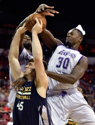 Los Angeles' Tarik Black and Julius Randle (30) block a shot by Utah's Jack Cooley (45) during an NBA Summer League game at the Thomas & Mack Center on Friday, July 17, 2015, in Las Ve ...