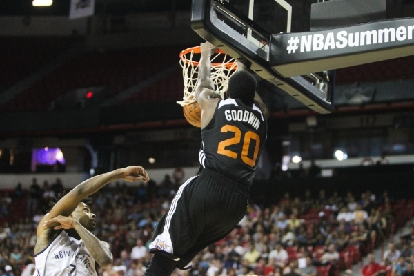 Archie Goodwin (20) dunks against Larry Drew II (7) at the Thomas and Mack Center in Las Vegas on Sunday, July 19, 2015. (James Tensuan/Las Vegas Review-Journal) Follow James Tensuan on Twitter