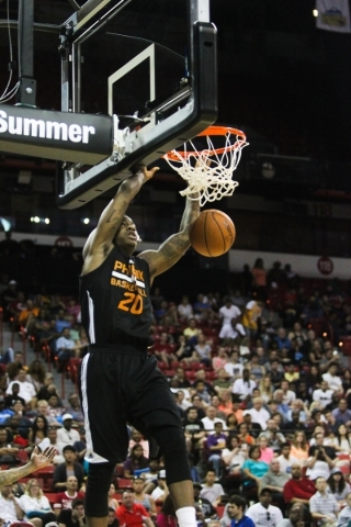 Archie Goodwin (20) dunks against the New Orleans Pelicans at the Thomas and Mack Center in Las Vegas on Sunday, July 19, 2015. (James Tensuan/Las Vegas Review-Journal) Follow James Tensuan on Twitter