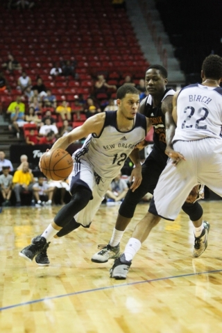 Seth Curry (12) dribbles the ball down the court during a game against the Phoenix Suns at the Thomas and Mack Center in Las Vegas on Sunday, July 19, 2015. (James Tensuan/Las Vegas Review-Journal ...