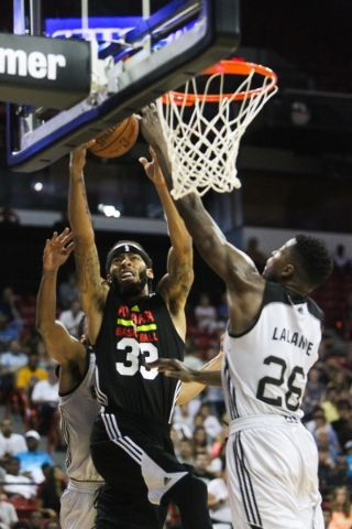 Terran Petteway (33) of the Atlanta Hawks attempts a layup against the San Antonio Spurs at the Thomas and Mack Center in Las Vegas on Sunday, July 19, 2015. (James Tensuan/Las Vegas Review-Journa ...