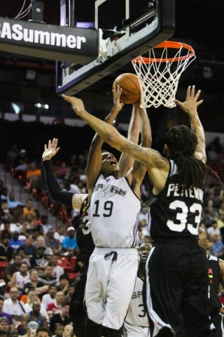 Jarrell Eddie (19) of the San Antonio Spurs is guarded by the Atlanta Blackhawks at the Thomas and Mack Center in Las Vegas on Sunday, July 19, 2015. (James Tensuan/Las Vegas Review-Journal) Follo ...