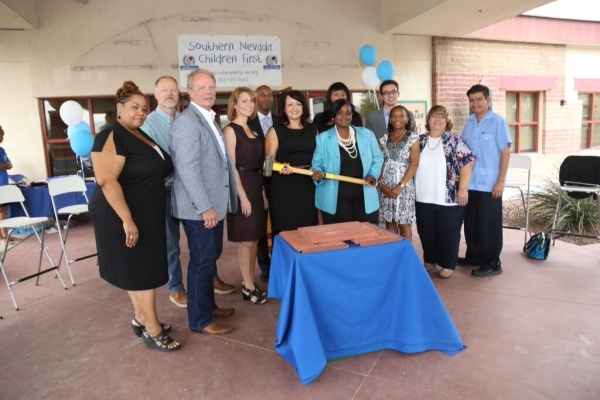 Members of the community, including those from Texas Station, Grand Canyon Development Partners and Southern Nevada Children First charity, attend a ceremonial tile breaking for the new headquarte ...