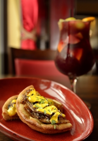 A sweet onion flatbread is shown with a Spanish red sangria at Tapas by Alex Stratta. (Bill Hughes/Las Vegas Review-Journal)