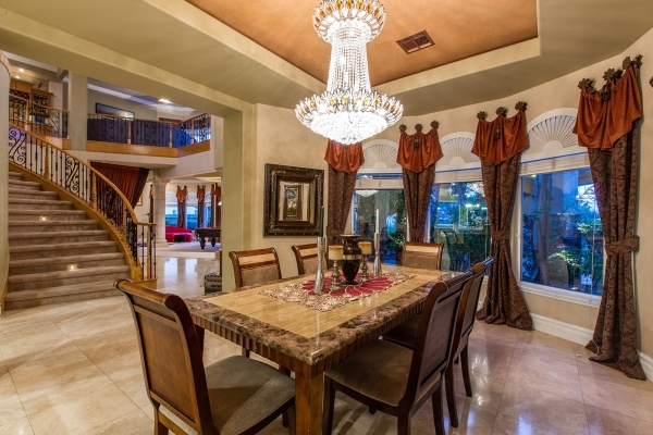 This luxury Newport Bay Drive home features a dining room near the elegant staircase. COURTESY PHOTO