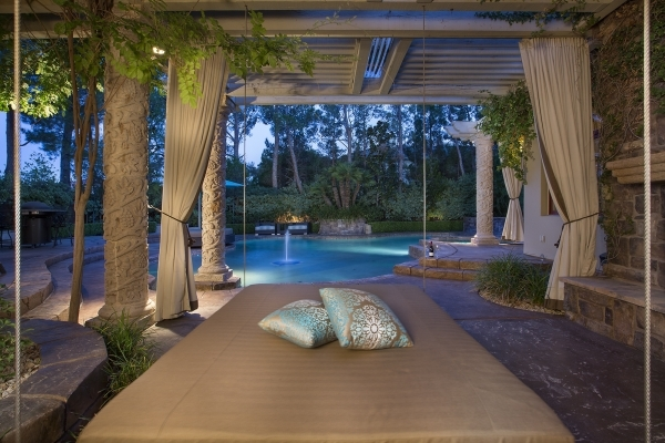 This Summerlin'€™s Trails village mansion features day beds in the patio area. COURTESY PHOTO