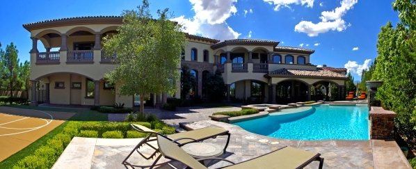 This Southern Higlands home is on the 11th hole at the exclusive Southern Highlands Golf Club. It has its own private putting green that is adjacent to a custom bar and cigar lounge. COURTESY PHOTO