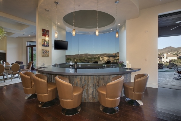 A 13,489-square-foot mansion features a stylish bar. COURTESY PHOTO