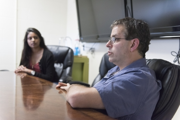 Professor Martin Schiller, executive director of the Nevada Institute of Personalized Medicine at UNLV'™s School of Life Sciences, and biology student Kiran Mathew speak during an interview ...