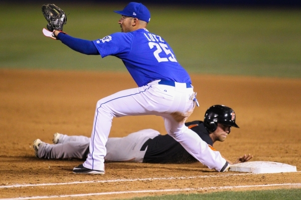 Zach Lutz (25) attempts to tag out a runner at first base at Cashman Field on Monday, July 20, 2015. Lutz is back with the 51s after playing baseball in Korea and Japan. (James Tensuan/Las Vegas R ...
