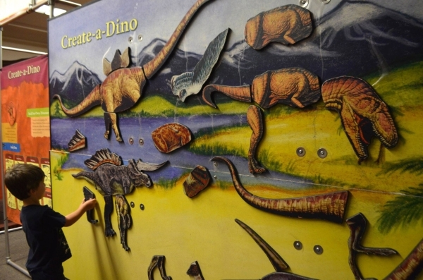 """Guests can create a dinosaur using interchangeable magnetic parts in the """"Dinosaur Revolution"""" exhibit at the Las Vegas Natural History Museum. (Ginger Meurer/Special to View)"""