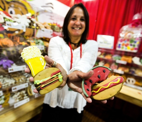 Lisa St. Clair, president of Tail Bangers, holds a selection of seasonal fresh baked dog treats during the Super Zoo convention at the Mandalay Bay Convention Center,  3950 South Las Vegas Bouleva ...