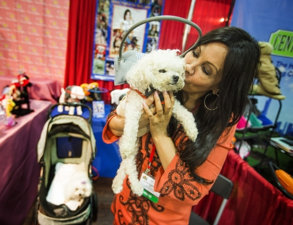 Sylvia Bordeaux, founder/owner of Muffin's Halo, kisses Muffin her blind dog, during the Super Zoo convention at the Mandalay Bay Convention Center,  3950 South Las Vegas Boulevard, on Tuesd ...