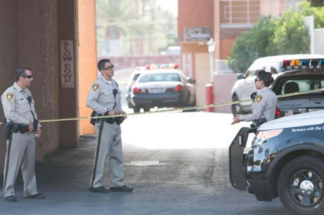 Metro investigates an overnight officer-involved shooting that left a man wounded in the parking lot of the Shalimar Hotel Las Vegas at 1401 Las Vegas Boulevard South on Saturday, July 18, 2015. ( ...