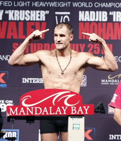 Light heavyweight champion Sergey Kovalev of Russia poses on the scale Friday at Mandalay Bay during the weigh-in for his IBF title defense against Nadjib Mohammedi of France tonight. BIZUAYEHU TE ...