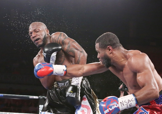 Jean Pascal of Canada, right, connects a right punch against Yuniesky Gonzalez of Cuba during their light heavyweights title match on Saturday, July 25, 2015 at Mandalay Bay hotel-casino. Pascal w ...