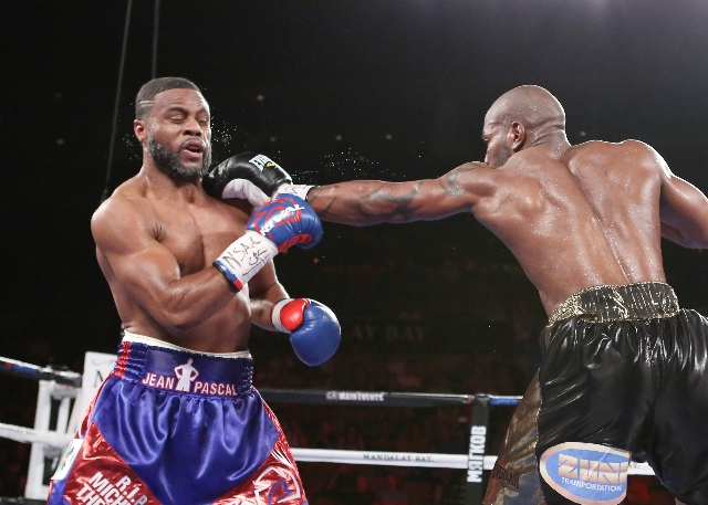 Yuniesky Gonzalez of Cuba, right, connects a left punch agains Jean Pascal of Canada during their light heavyweights title match on Saturday, July 25, 2015 at Mandalay Bay hotel-casino. Pascal won ...