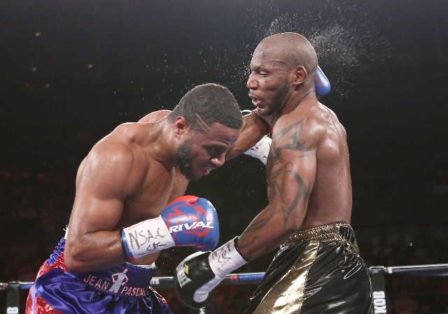 Jean Pascal of Canada, left, connects a left punch against Yuniesky Gonzalez of Cuba during their light heavyweights title match on Saturday, July 25, 2015 at Mandalay Bay hotel-casino. Pascal won ...