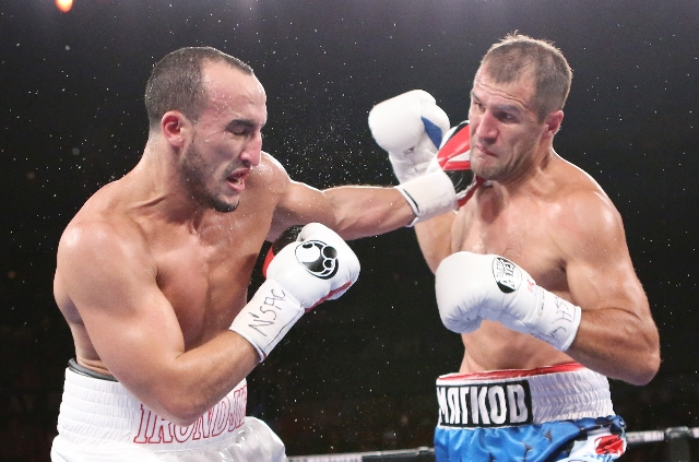 Nadjib Mohammedi of France, left, fights back after beeing punched by light heavyweight champ Sergey Kovalev of Russia during their IBF light heavyweight title bout on Saturday, July 25, 2015 at M ...