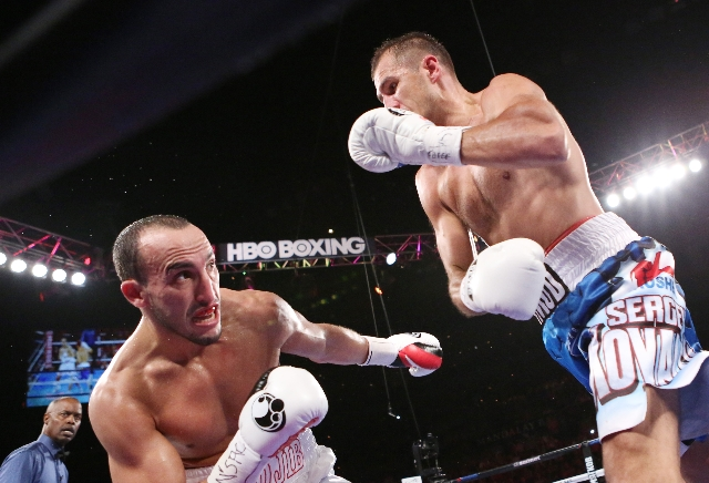 Nadjib Mohammedi of France, left, dodges a punch from light heavyweight champ Sergey Kovalev of Russia during their IBF light heavyweight title bout on Saturday, July 25, 2015 at Mandalay Bay hote ...