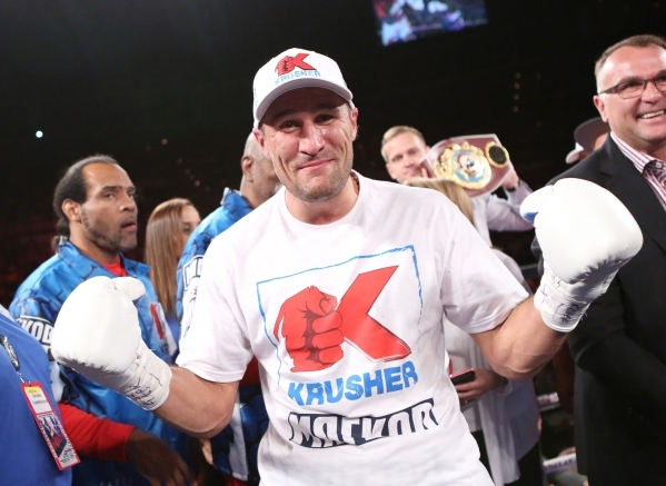 Sergey Kovalev of Russia celebrates retaining his IBF light heavyweight championship by scoring a third-round knockout of France's Nadjib Mohammedi at the Mandalay Bay Events Center. (Bizuay ...