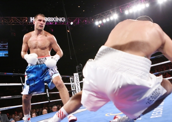 IBF light heavyweight champ Sergey Kovalev, left, of Russia knocks down Nadjib Mohammedi of France in the third round of their title fight at the Mandalay Bay Events Center on Saturday. Kovalev wo ...
