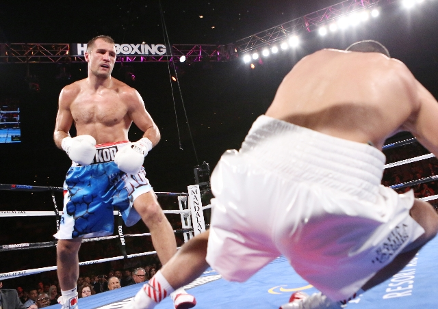 Light heavyweight champ Sergey Kovalev, left, of Russia knocks down Nadjib Mohammedi of France in the third round during their IBF light heavyweight title bout on Saturday, July 25, 2015 at Mandal ...