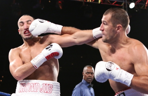 IBF light heavyweight champion Sergey Kovalev of Russia, right, drills a right hand into the face of  Nadjib Mohammedi of France during their title fight at the Mandalay Bay Events Center on Satur ...