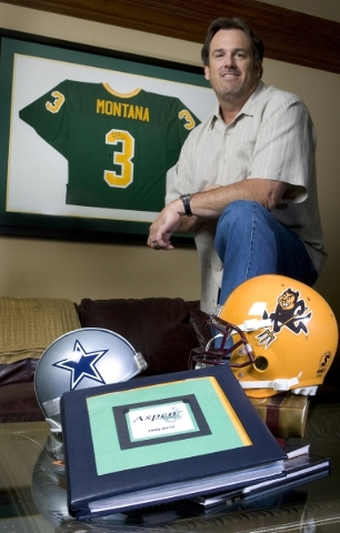 Jeffrey Guinn, son of then-Nevada Gov. Kenny Guinn, is surrounded by sports memorabilia May 26, 2006, in his office at Aspen Financial Services. (Clint Karlsen/Las Vegas Review-Journal file photo)