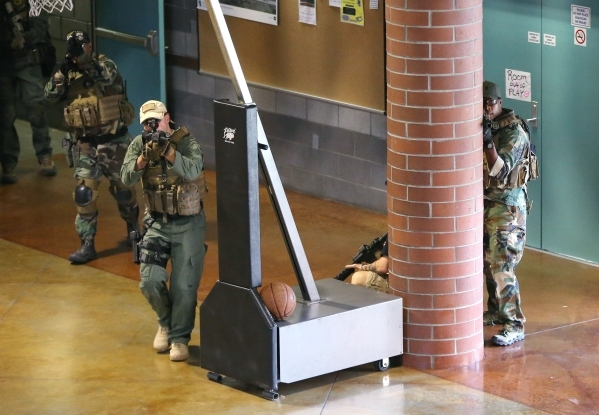 Carson City Sheriff's SWAT members respond to an active shooter drill at the Adjutant General complex in Carson City, Nev., on Wednesday, July 22, 2015. Nevada National Guard, Carson City Sh ...
