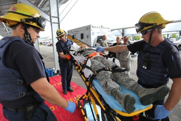 Emergency crews respond to an active shooter drill at the Adjutant General complex in Carson City, Nev., on Wednesday, July 22, 2015. Nevada National Guard, Carson City Sheriff and Fire department ...