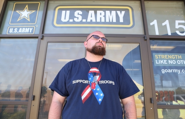 Josh Martin of Las Vegas stands guard outside the U.S. Military Recruiting Center on 455 W. Craig Rd. in Las Vegas on Wednesday, July 22, 2015. (Bizuayehu Tesfaye/Las Vegas Review-Journal) Follow  ...