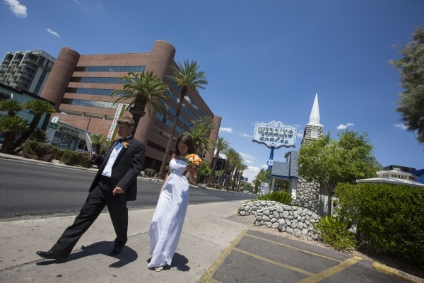 Sergiu Opinca, left, and Zarema Zinnurova walk outside of the Graceland Wedding Chapel, 619 S. Las Vegas Blvd., after getting married on Tuesday, July 21, 2015, in downtown Las Vegas. Clark County ...
