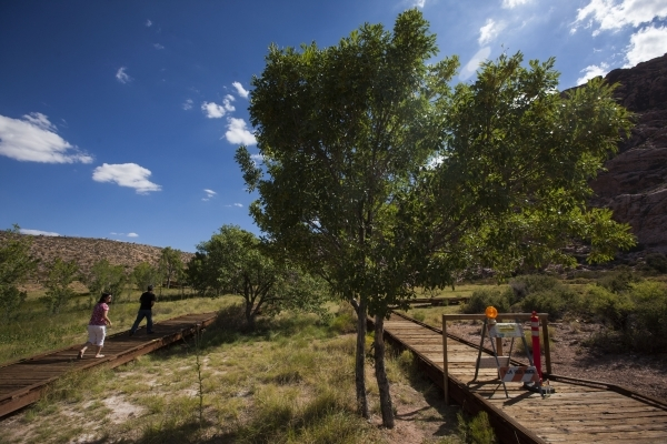 A blocked off portion of the boardwalk is seen, right, as Nan and John Lin walk by at the Red Springs picnic area in the Red Rock Canyon National Conservation Area on Tuesday, July 21, 2015. A por ...