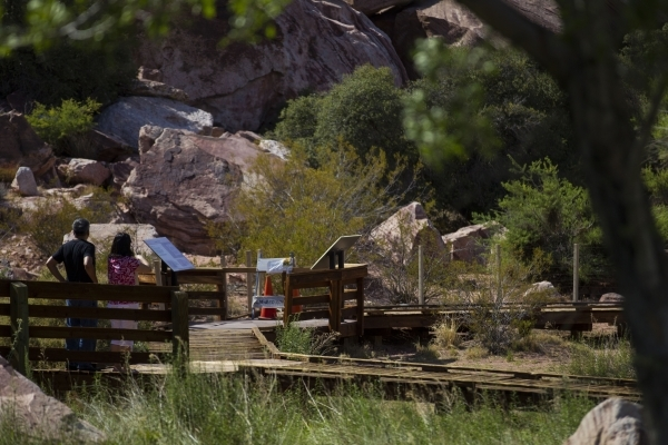 John Lin, left, and Nan Lin pause as they approach a blocked off portion of the boardwalk at the Red Springs picnic area in the Red Rock Canyon National Conservation Area on Tuesday, July 21, 2015 ...