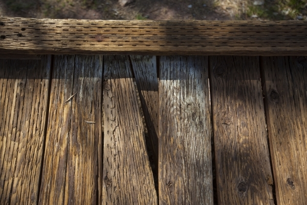 Part of broken wooden plank is seen on the boardwalk as people walk by at the Red Springs picnic area in the Red Rock Canyon National Conservation Area on Tuesday, July 21, 2015. A portion of the  ...