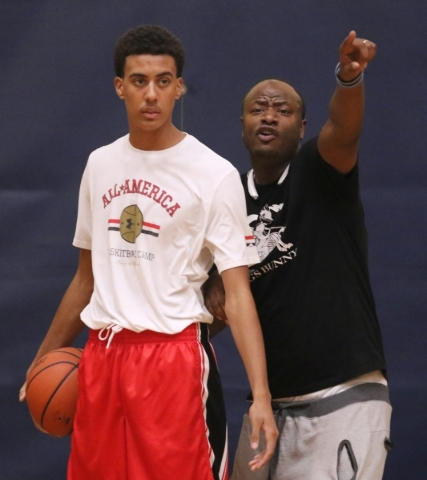 Greg Floyd Jr., left, stands near Coach Lamar Bigby during a Las Vegas Knicks basketball practice at Tarkanian Basketball Academy Tuesday, July 21, 2015, in Las Vegas. Floyd is a sophomore at Dese ...