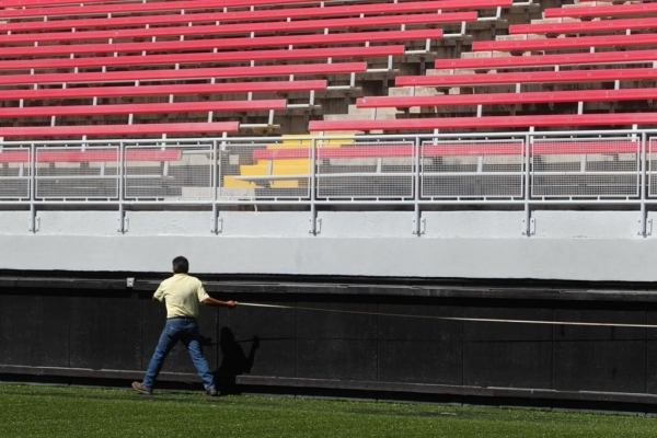 Gilbert Phelps of J.A. Tiberti measures the side of the Sam Boyd Stadium on Thursday, July 23 2015. The Sam Boyd stadium got new turf and widened the field to better accommodate rugby and soccer.  ...